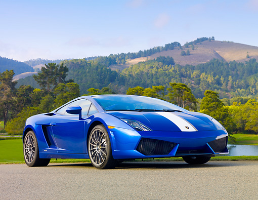 LAM 01 BK0006 01 © Kimball Stock 2010 Lamborghini Gallardo LP550-2 Valentino Balboni Blue 3/4 Front View On Pavement By Hills