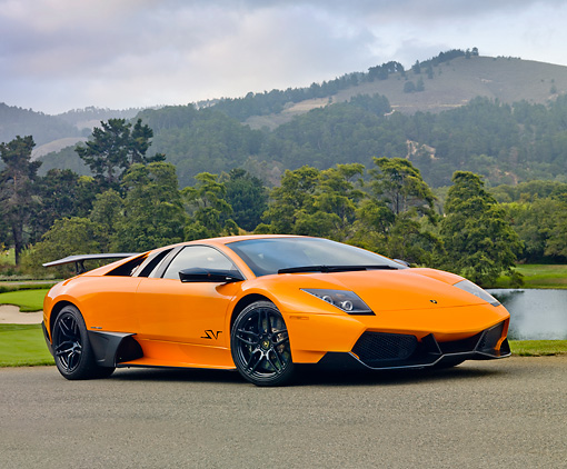 LAM 01 BK0011 01 © Kimball Stock 2010 Lamborghini Murci�lago LP670-4 SV Orange 3/4 Front View On Pavement By Hills