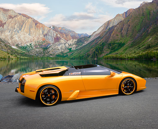 LAM 01 RK0546 02 © Kimball Stock 2005 Lamborghini, Murcielago, Spider, Orange Pearl 3/4 Rear View On Pavement By Lake