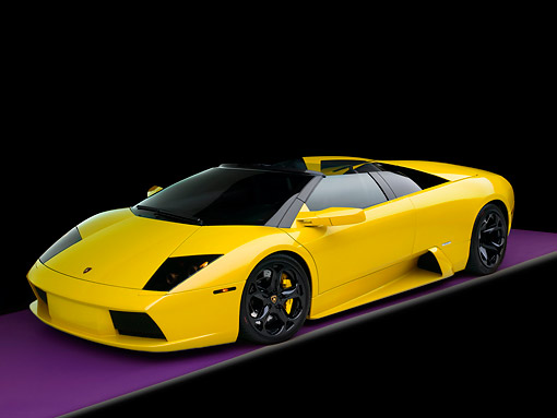 LAM 01 RK0630 01 © Kimball Stock 2006 Lamborghini Murcielago Roadster Yellow 3/4 Side View Studio