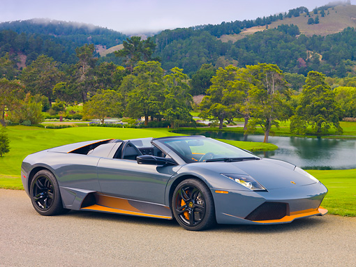 LAM 01 RK0751 01 © Kimball Stock 2010 Lamborghini Murcielago LP650 Roadster Gray And Orange 3/4 Front View On Pavement By Golf Course