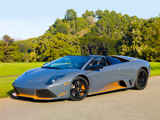 LAM 01 RK0753 01 © Kimball Stock 2010 Lamborghini Murcielago LP650 Roadster Gray And Orange 3/4 Front View On Pavement By Golf Course