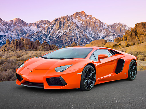 LAM 01 RK0757 01 © Kimball Stock 2012 Lamborghini Aventador LP700-4 Orange 3/4 Front View On Pavement By Snowy Mountains