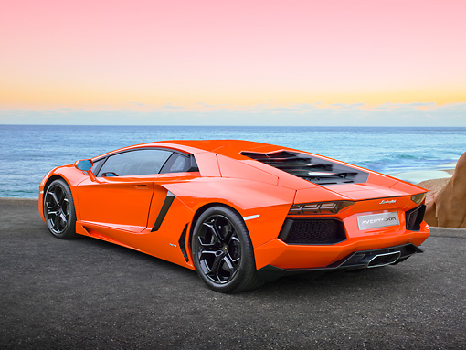 LAM 01 RK0761 01 © Kimball Stock 2012 Lamborghini Aventador Orange 3/4 Rear View On Pavement By Beach At Dusk