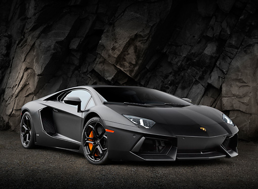 LAM 01 RK0773 01 © Kimball Stock 2012 Lamborghini Aventador Black 3/4 Front View On Gravel By Stone Wall