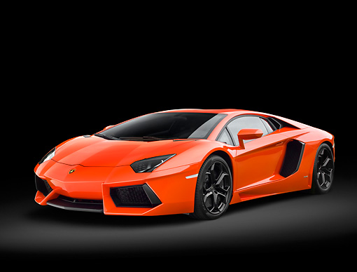 LAM 01 RK0776 01 © Kimball Stock 2012 Lamborghini Aventador Orange 3/4 Front View In Studio