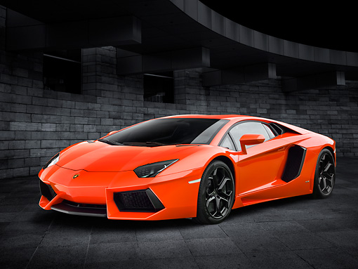LAM 01 RK0778 01 © Kimball Stock 2012 Lamborghini Aventador Orange 3/4 Front View By Stone Wall