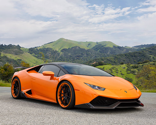 LAM 01 RK0806 01 © Kimball Stock 2015 Lamborghini Huracan Orange 3/4 Front View By Mountain And Trees