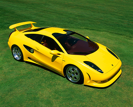 LAM 01 RK0015 08 © Kimball Stock Lamborghini Cala Italdesign Yellow Overhead 3/4 Side View On Pavement By Lake And Trees