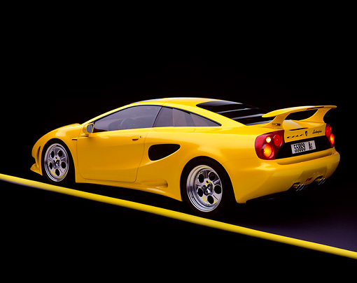 LAM 01 RK0018 09 © Kimball Stock Lamborghini Cala Italdesign Yellow 3/4 Rear View On Yellow Line Studio