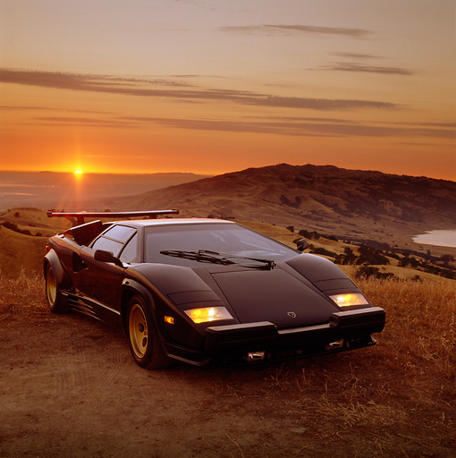 LAM 01 RK0081 10 © Kimball Stock Lamborghini Countach Black 3/4 Front View On Dry Grass Hill At Sunset