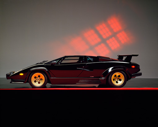 LAM 01 RK0120 02 © Kimball Stock 1988 Lamborghini Countach Black Profile View Studio