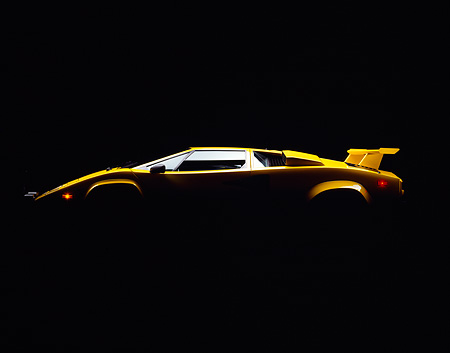 LAM 01 RK0134 12 © Kimball Stock Silhouette Of Lamborghini Countach Yellow Profile Studio