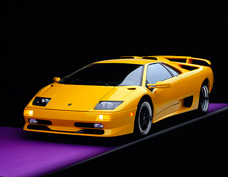 LAM 01 RK0156 08 © Kimball Stock 1999 Lamborghini SV Diablo Yellow 3/4 Front View On Purple Floor Gray Line Studio
