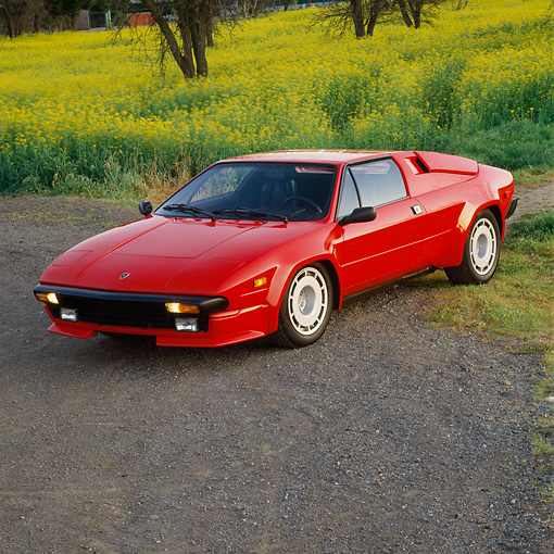 LAM 01 RK0286 04 © Kimball Stock 1988 Lamborghini Jalpa Red Overhead 3/4 Front View On Pavement