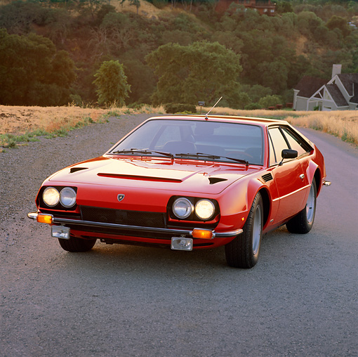 LAM 01 RK0319 01 © Kimball Stock 1976 Lamborghini Jarama Red 3/4 Front View On Pavement
