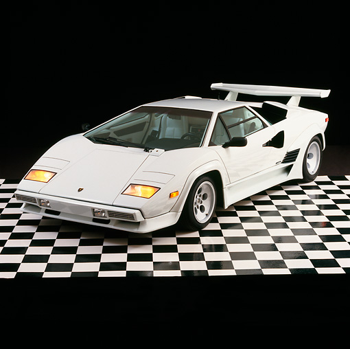 LAM 01 RK0338 26 © Kimball Stock Lamborghini Countach White 3/4 Front View On Checkered Floor Studio
