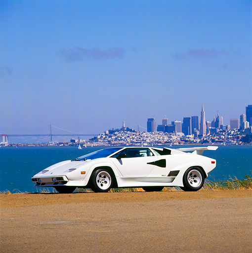 LAM 01 RK0436 07 © Kimball Stock Lamborghini Countach White 3/4 Front View By San Francisco Skyline Blue Sky