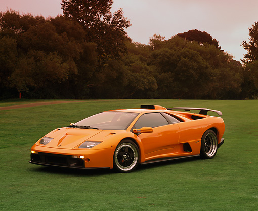 LAM 01 RK0447 01 © Kimball Stock 2000 Lamborghini GT Orange 3/4 Side View On Grass
