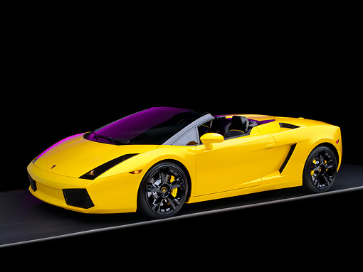 LAM 01 RK0554 01 © Kimball Stock 2007 Lamborghini Gallardo Roadster Yellow 3/4 Side View Studio