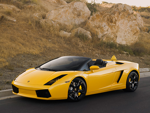 LAM 01 RK0567 01 © Kimball Stock 2007 Lamborghini Gallardo Roadster Yellow 3/4 Front View On Pavement