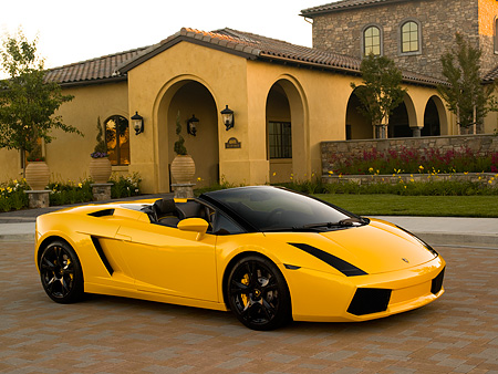 LAM 01 RK0571 01 © Kimball Stock 2007 Lamborghini Gallardo Roadster Yellow 3/4 Side View On Pavement