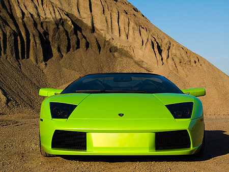 LAM 01 RK0586 01 © Kimball Stock 2006 Lamborghini Murcielago Roadster Lime Green Low Head On View On Sand