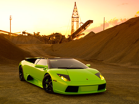 LAM 01 RK0593 01 © Kimball Stock 2006 Lamborghini Murcielago Roadster Lime Green 3/4 Front View On Sand