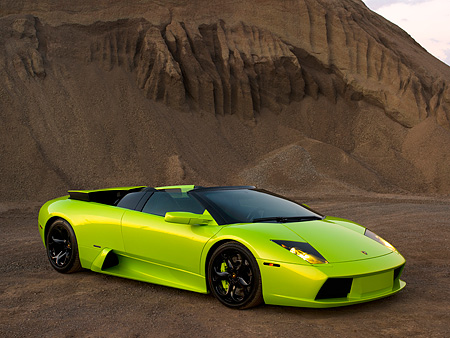 LAM 01 RK0595 01 © Kimball Stock 2006 Lamborghini Murcielago Roadster Lime Green 3/4 Side View On Sand