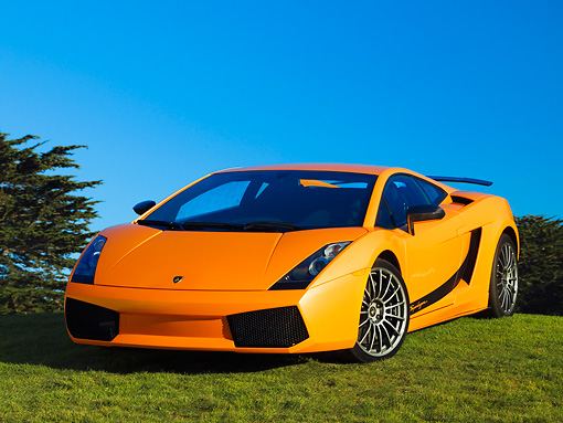 LAM 01 RK0633 02 © Kimball Stock 2007 Lamborghini Gallardo Superleggera Orange With Black Stripe Front 3/4 View On Grass Blue Sky