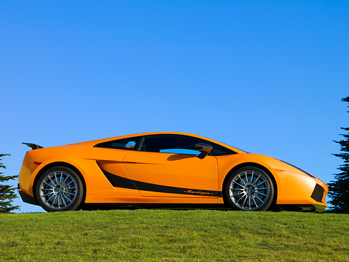LAM 01 RK0636 02 © Kimball Stock 2007 Lamborghini Gallardo Superleggera Orange With Black Stripe 3/4 Front View On Grass Blue Sky