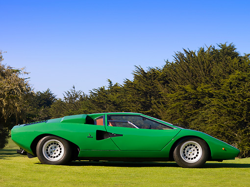 LAM 01 RK0641 02 © Kimball Stock 1974 Lamborghini Countach LP400 Green Profile View On Grass Trees Blue Sky