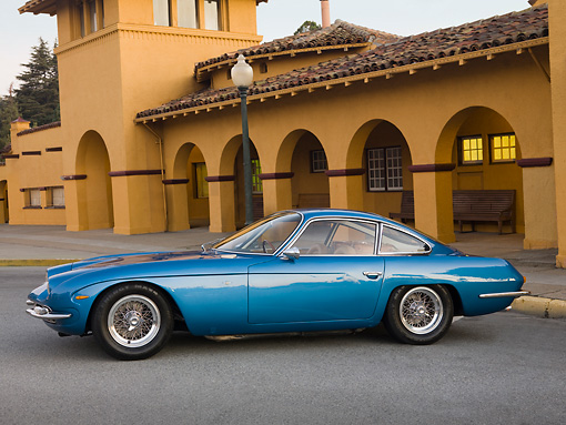 LAM 01 RK0686 01 © Kimball Stock 1965 First Lamorghini 350GT Azure Blue Profile View On Pavement By Building