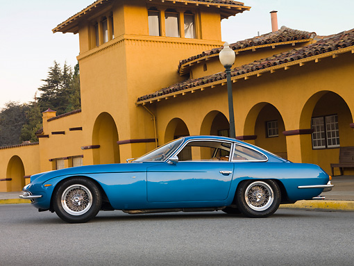 LAM 01 RK0687 01 © Kimball Stock 1965 First Lamorghini 350GT Azure Blue Profile View On Pavement By Building