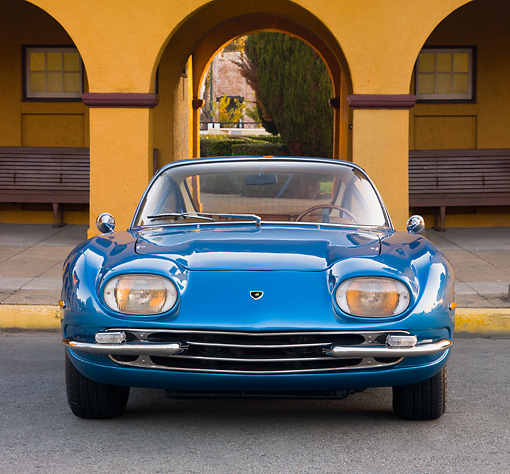 LAM 01 RK0688 01 © Kimball Stock 1965 First Lamorghini 350GT Azure Blue Front View On Pavement By Building