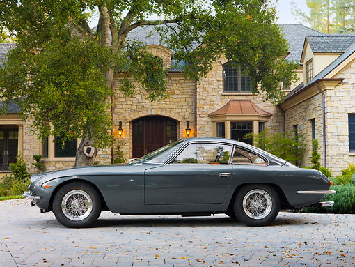 LAM 01 RK0693 01 © Kimball Stock 1966 First Lamorghini 400GT 2+2 Touring Berlinetta Grigio Saint-Vincent (Dark Gray) Profile View On Driveway By House