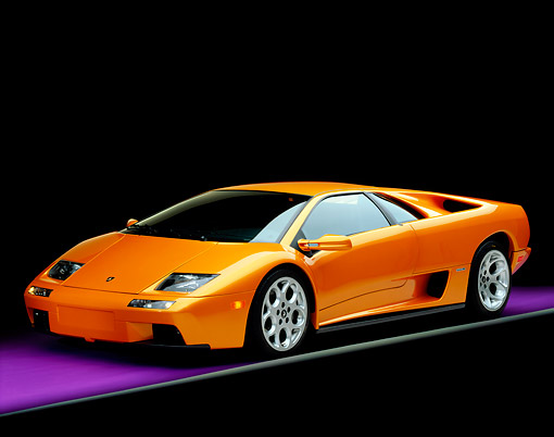 LAM 02 RK0143 03 © Kimball Stock 2001 Lamborghini Diablo 6L Orange 3/4 Front View On Purple Floor Gray Line Studio
