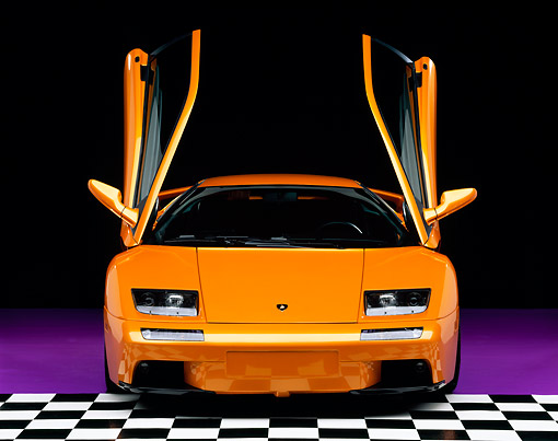 LAM 02 RK0147 08 © Kimball Stock 2001 Lamborghini Diablo 6L Orange Head On Shot Checkered Floor Studio