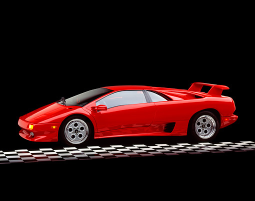 LAM 02 RK0001 06 © Kimball Stock 1994 Lamborghini Diablo VT Red 3/4 Side View On Checkerboard Studio