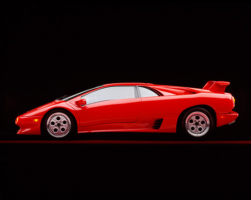 LAM 02 RK0004 04 © Kimball Stock 1994 Lamborghini Diablo VT Red Profile View On Studio