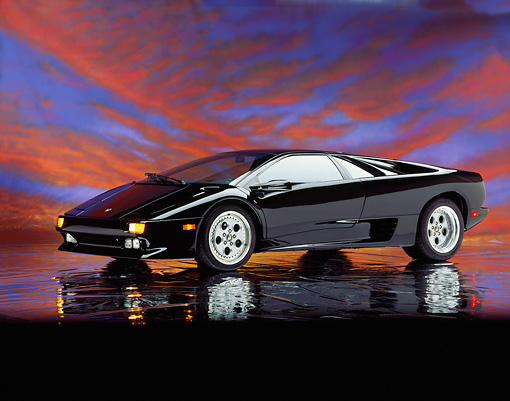 LAM 02 RK0016 07 © Kimball Stock 1994 Lamborghini Diablo Black Side 3/4 View On Mylar Floor Sunset Studio