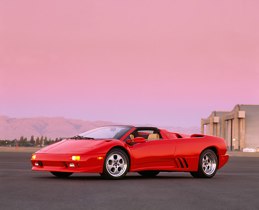 LAM 02 RK0030 01 © Kimball Stock 1996 Lamborghini Diablo Roadster Red 3/4 Side View On Pavement