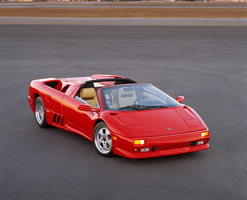 LAM 02 RK0032 15 © Kimball Stock 1996 Lamborghini Diablo Roadster Red 3/4 Front View On Pavement