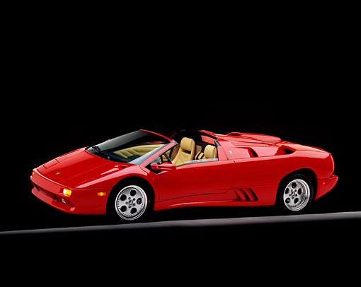 LAM 02 RK0044 03 © Kimball Stock 1996 Lamborghini Diablo Roadster Red 3/4 Side View On Gray Line Studio