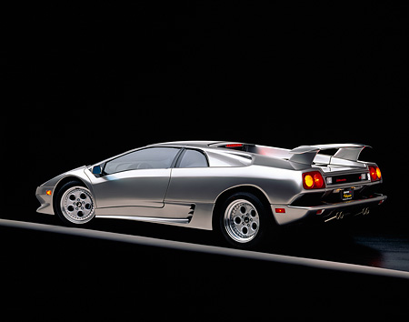LAM 02 RK0048 05 © Kimball Stock 1995 Lamborghini Diablo VT Silver 3/4 Rear View On Gray Line Studio