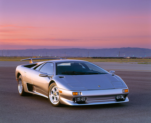 LAM 02 RK0057 03 © Kimball Stock 1995 Lamborghini Diablo VT Silver 3/4 Front View On Pavement At Dusk