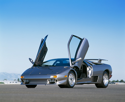 LAM 02 RK0064 02 © Kimball Stock 1995 Lamborghini Diablo VT Silver Low 3/4 Front View On Pavement