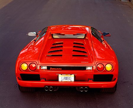 LAM 02 RK0068 22 © Kimball Stock 1991 Lamborghini Diablo Red Rear Shot On Pavement