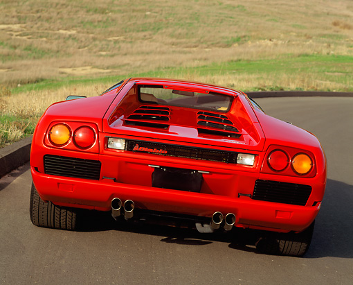 LAM 02 RK0070 04 © Kimball Stock 1991 Lamborghini Diablo Red Rear View On Curve By Grass