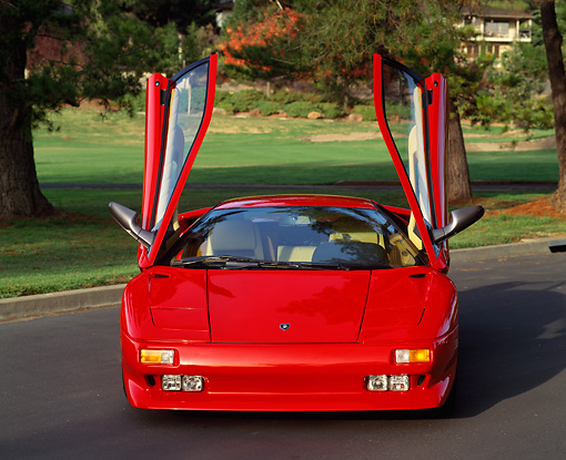 LAM 02 RK0071 06 © Kimball Stock 1991 Lamborghini Diablo Red Head On View On Pavement Doors Open